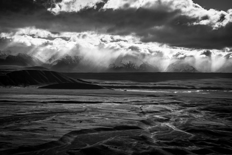 Alpine Valleys, New Zealand Fine Art Photo Print. A weather front is converges over the Ben Ohau Range exposing the valleys to icy rain and snow.